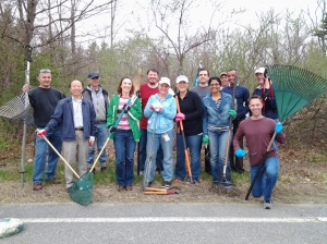 photo of Devens area employees cleaning a new hiking trail on Earth Day